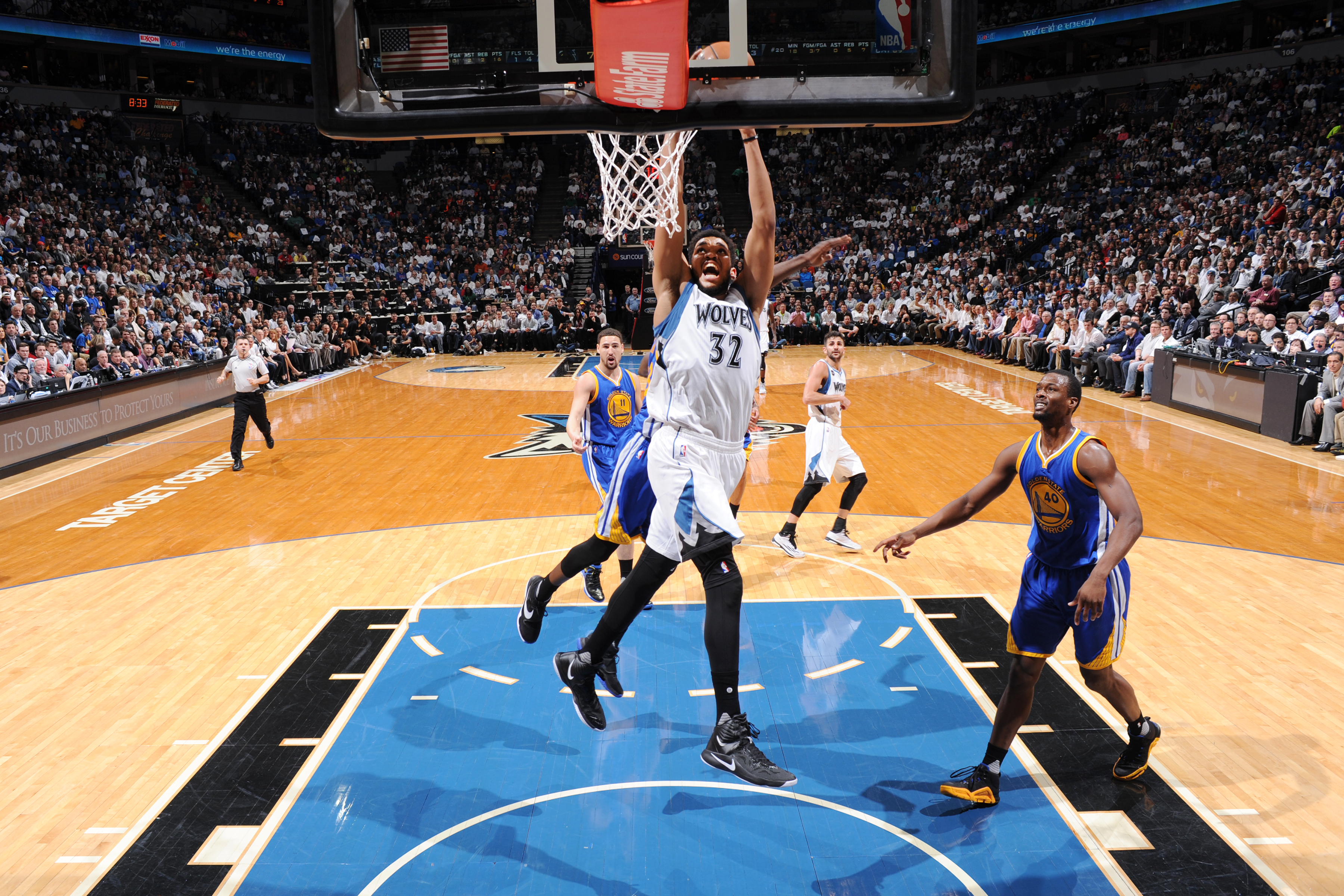 MINNEAPOLIS, MN -  MARCH 21:  Karl-Anthony Towns #32 of the Minnesota Timberwolves goes up for a dunk against the Golden State Warriors on March 21, 2016 at Target Center in Minneapolis, Minnesota. NOTE TO USER: User expressly acknowledges and agrees that, by downloading and or using this Photograph, user is consenting to the terms and conditions of the Getty Images License Agreement. Mandatory Copyright Notice: Copyright 2016 NBAE (Photo by Garrett Ellwood/NBAE via Getty Images)