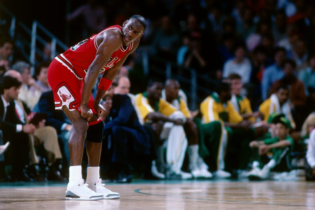 SEATTLE, WA - 1988: Michael Jordan #23 of the Chicago Bulls looks on against the Seattle Supersonics at the Seattle Coliseum in Seattle, Washington circa 1988. NOTE TO USER: User expressly acknowledges and agrees that, by downloading and or using this photograph, User is consenting to the terms and conditions of the Getty Images License Agreement. Mandatory Copyright Notice: Copyright 1988NBAE (Photo by Brian Drake/NBAE via Getty Images)