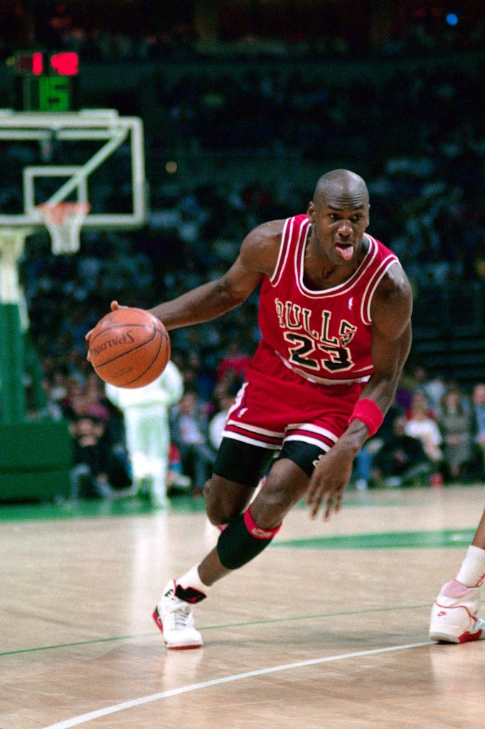 MILWAUKEE - 1988: Michael Jordan #23 of the Chicago Bulls dribbles against the Milwaukee Bucks circa 1988 at the Bradley Center in Milwaukee, Wisconsin. NOTE TO USER: User expressly acknowledges and agrees that, by downloading and/or using this photograph, user is consenting to the terms and conditions of the Getty Images License Agreement. Mandatory Copyright Notice: Copyright 1988 NBAE (Photo by Robert Lewis/NBAE via Getty Images)