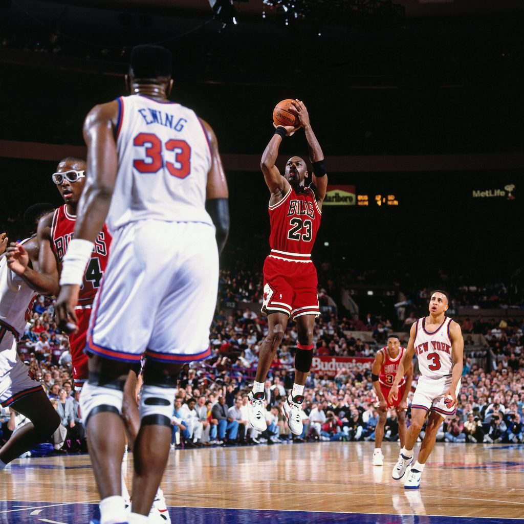 NEW YORK - CIRCA 1991: Michael Jordan #23 of the Chicago Bulls shoots against the New York Knicks circa 1991 at Madison Square Garden in New York. NOTE TO USER: User expressly acknowledges and agrees that, by downloading and or using this photograph, User is consenting to the terms and conditions of the Getty Images License Agreement. Mandatory Copyright Notice: Copyright 1991 NBAE (Photo by Brian Drake/NBAE via Getty Images)