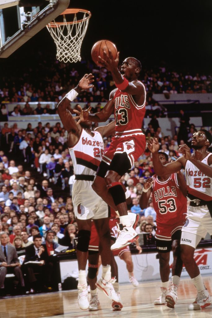 PORTLAND, OR - 1991: Michael Jordan #23 of the Chicago Bulls shoots against the Portland Trailblazers during a game played at the Veterans Memorial Coliseum in Portland, Oregon circa 1991. NOTE TO USER: User expressly acknowledges and agrees that, by downloading and/or using this Photograph, user is consenting to the terms and conditions of the Getty Images License Agreement. Mandatory Copyright Notice: Copyright 1991 NBAE (Photo by Brian Drake/NBAE via Getty Images)