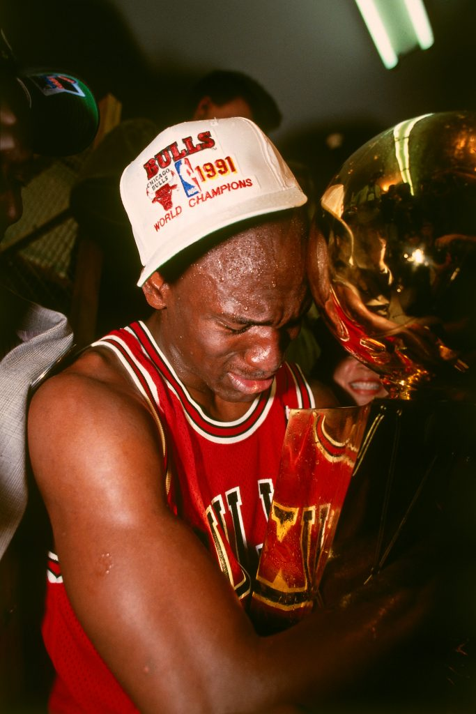INGLEWOOD, CA- JUNE 12: Michael Jordan #23 of the Chicago Bulls celebrates following Game Five of the 1991 NBA Finals on June 12, 1991 at the Great Western Forum in Inglewood, California. NOTE TO USER: User expressly acknowledges and agrees that, by downloading and/or using this Photograph, user is consenting to the terms and conditions of the Getty Images License Agreement. Mandatory Copyright Notice: Copyright 1991 NBAE (Photo by Andrew D. Bernstein/NBAE via Getty Images)