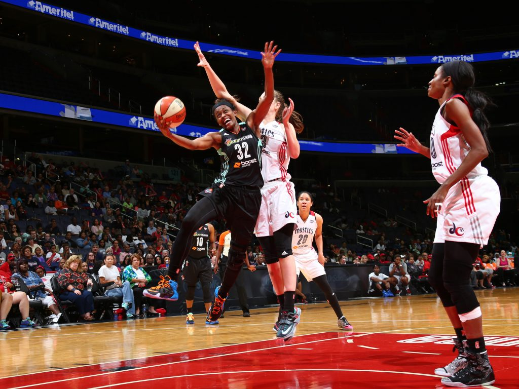 WASHINGTON, DC - SEPTEMBER 20: Swin Cash #32 of the New York Liberty drives to the basket against the Washington Mystics in Game Two of the WNBA Western Conference Semifinals on September 20, 2015 at the Verizon Center in Washington, DC. NOTE TO USER: User expressly acknowledges and agrees that, by downloading and or using this Photograph, user is consenting to the terms and conditions of the Getty Images License Agreement. Mandatory Copyright Notice: Copyright 2015 NBAE (Photo by Ned Dishman/NBAE via Getty Images)