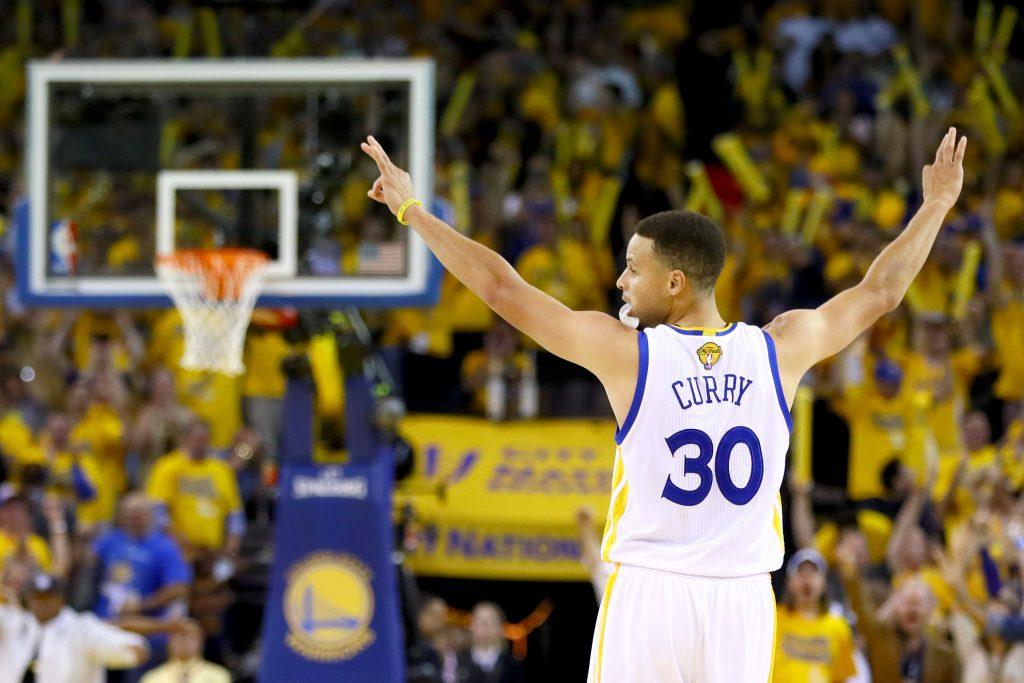 OAKLAND, CA - JUNE 19: Stephen Curry #30 of the Golden State Warriors reacts after scoring a three-point basket against the Cleveland Cavaliers in Game 7 of the 2016 NBA Finals at ORACLE Arena on June 19, 2016 in Oakland, California. NOTE TO USER: User expressly acknowledges and agrees that, by downloading and or using this photograph, User is consenting to the terms and conditions of the Getty Images License Agreement. (Photo by Ezra Shaw/Getty Images)
