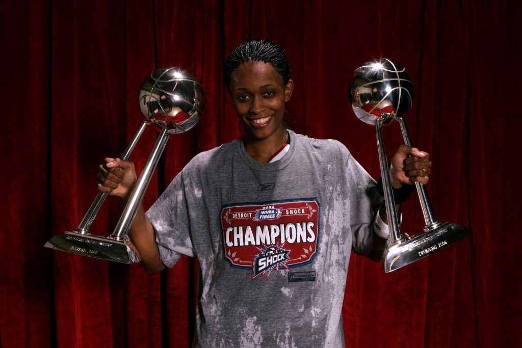 DETROIT, MI - SEPTEMBER 9: Swin Cash #32 of the 2006 WNBA Champion Detroit Shock poses with the WNBA Championship trophies after winning Game Five of the WNBA Finals 80 to 75 against the Sacramento Monarchs September 9, 2006 at Joe Louis Arena in Detroit, Michigan. NOTE TO USER: User expressly acknowledges and agrees that, by downloading and/or using this Photograph, user is consenting to the terms and conditions of the Getty Images License Agreement. Mandatory Copyright Notice: Copyright 2006 NBAE (Photo by Garrett W. Ellwood/NBAE via Getty Images)
