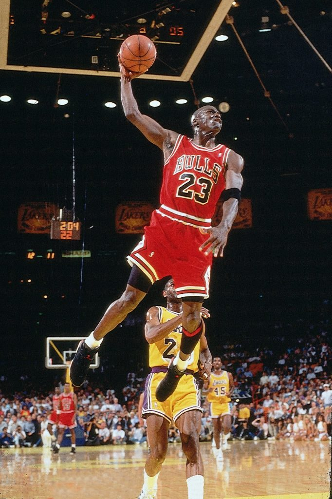 INGLEWOOD, CA - JUNE 12: Michael Jordan #23 of the Chicago Bulls goes for a dunk against the Los Angeles Lakers in game five of the 1991 NBA Finals on June 12, 1991 at the Great Western Forum in Inglewood, California. The Bulls won 108-101 NOTE TO USER: User expressly acknowledges and agrees that, by downloading and or using this Photograph, user is consenting to the terms and conditions of the Getty Images License Agreement. Mandatory Copyright Notice: Copyright 1991 NBAE (Photo by Andrew D. Bernstein/NBAE via Getty Images)