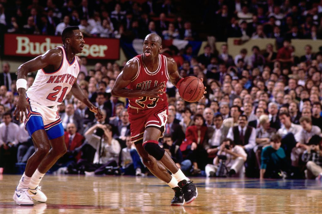 NEW YORK - 1991: Michael Jordan #23 of the Chicago Bulls moves the bal up court against the New York Knicks during a game played in 1991 at Madison Square Garden in New York, New York. NOTE TO USER: User expressly acknowledges and agrees that, by downloading and or using this photograph, User is consenting to the terms and conditions of the Getty Images License Agreement. Mandatory Copyright Notice: Copyright 1991 NBAE (Photo by Nathaniel S. Butler/NBAE via Getty Images)