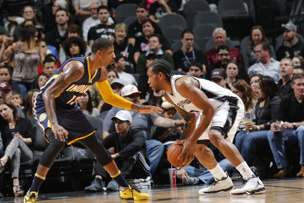 SAN ANTONIO, TX - DECEMBER 21:  Kawhi Leonard #2 of the San Antonio Spurs handles the ball against Paul George #13 of the Indiana Pacers on December 21, 2015 at the AT&T Center in San Antonio, Texas. NOTE TO USER: User expressly acknowledges and agrees that, by downloading and or using this photograph, user is consenting to the terms and conditions of the Getty Images License Agreement. Mandatory Copyright Notice: Copyright 2014 NBAE (Photos by Chris Covatta/NBAE via Getty Images)