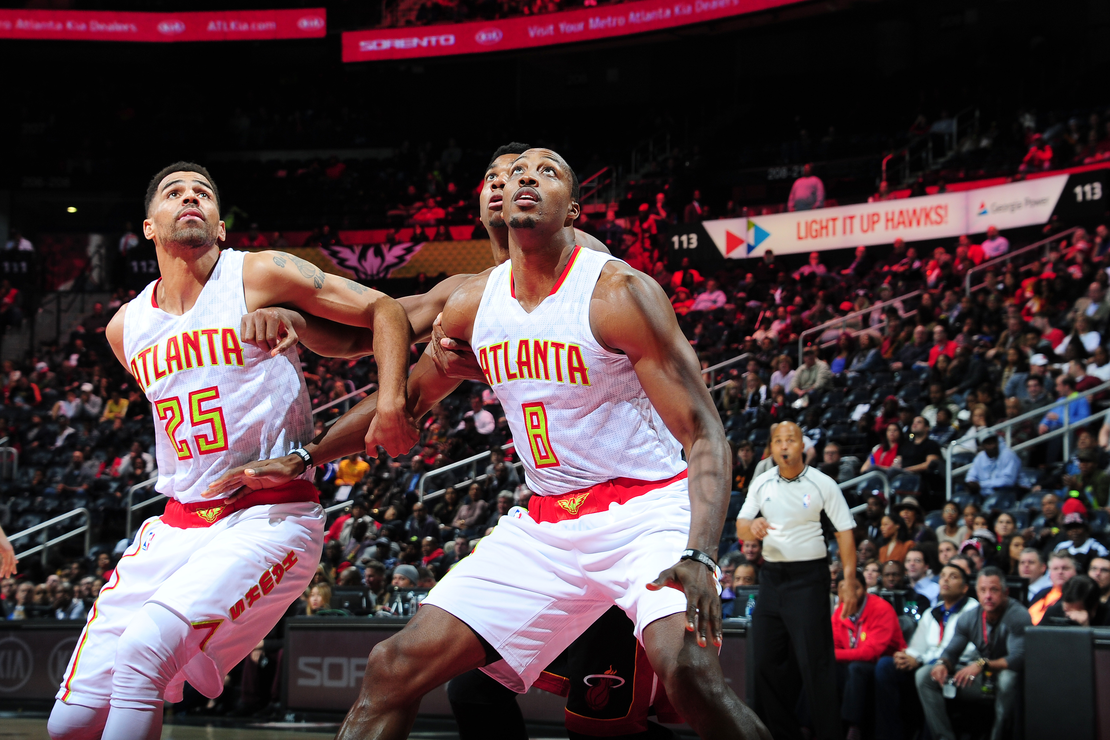 ATLANTA, GA - DECEMBER 7: Dwight Howard #8 and Thabo Sefolosha #25 of the Atlanta Hawks boxes out against the Miami Heat on December 7, 2016 at Philips Arena in Atlanta, Georgia.  NOTE TO USER: User expressly acknowledges and agrees that, by downloading and/or using this Photograph, user is consenting to the terms and conditions of the Getty Images License Agreement. Mandatory Copyright Notice: Copyright 2016 NBAE (Photo by Scott Cunningham/NBAE via Getty Images)