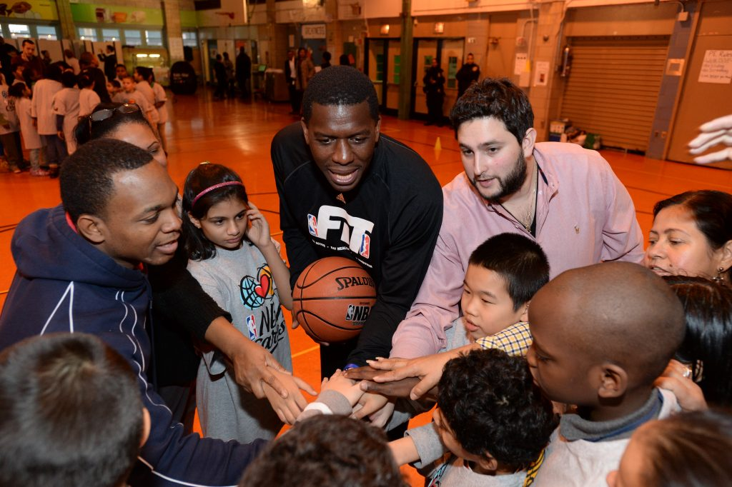 NEW YORK, NY- DECEMBER 11: Felipe Lopez huddles with students during the NBA Cares event at PS 208 on December 11, 2014 in New York, New York. NOTE TO USER: User expressly acknowledges and agrees that, by downloading and/or using this Photograph, user is consenting to the terms and conditions of the Getty Images License Agreement. Mandatory Copyright Notice: Copyright 2014 NBAE (Photo by Jennifer Pottheiser/NBAE via Getty Images)