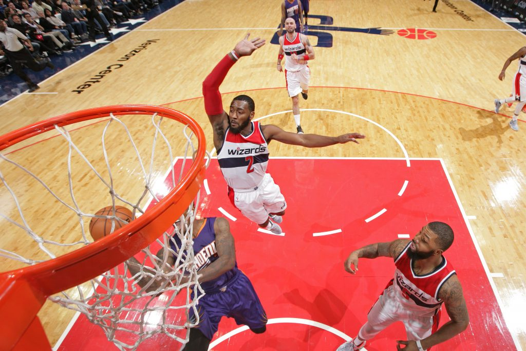 WASHINGTON, DC - NOVEMBER 21: John Wall #2 of the Washington Wizards blocks the shot of Eric Bledsoe #2 of the Phoenix Suns on November 21, 2016 at Verizon Center in Washington, DC. NOTE TO USER: User expressly acknowledges and agrees that, by downloading and or using this Photograph, user is consenting to the terms and conditions of the Getty Images License Agreement. Mandatory Copyright Notice: Copyright 2016 NBAE (Photo by Ned Dishman/NBAE via Getty Images)