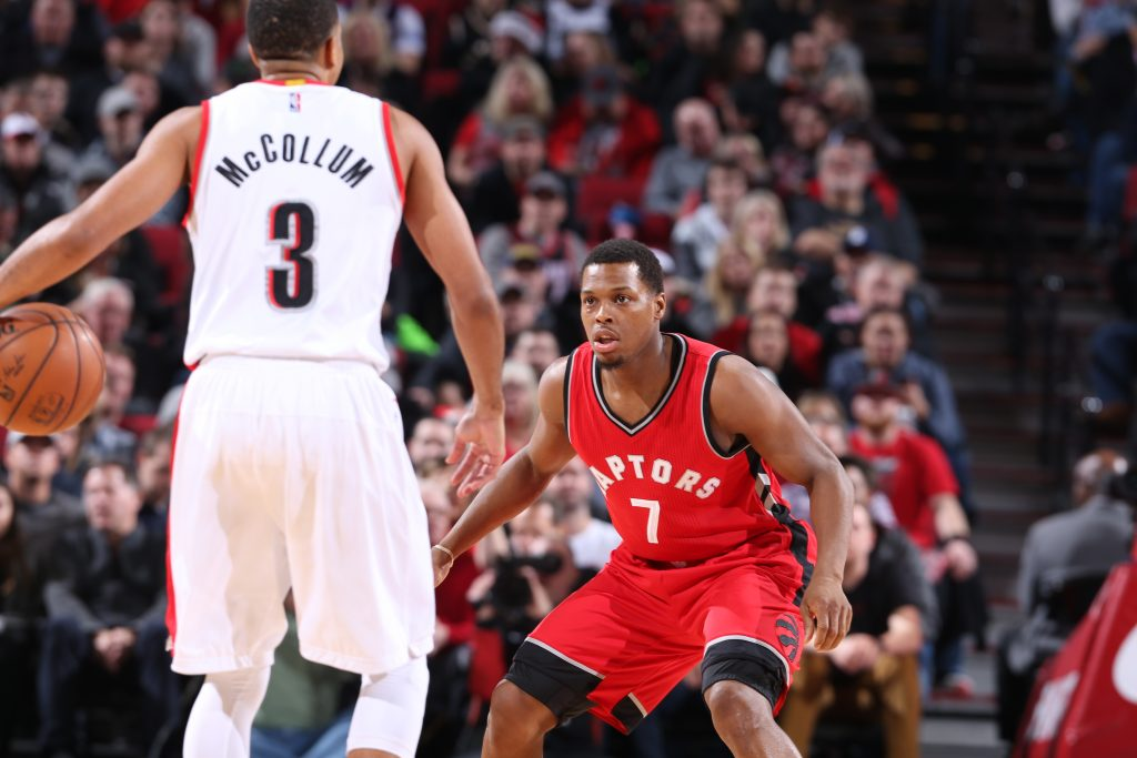 PORTLAND, OR - DECEMBER 26: Kyle Lowry #7 of the Toronto Raptors plays tight defense against the Portland Trail Blazers during the game on December 26, 2016 at the Moda Center in Portland, Oregon. NOTE TO USER: User expressly acknowledges and agrees that, by downloading and or using this Photograph, user is consenting to the terms and conditions of the Getty Images License Agreement. Mandatory Copyright Notice: Copyright 2016 NBAE (Photo by Sam Forencich/NBAE via Getty Images)