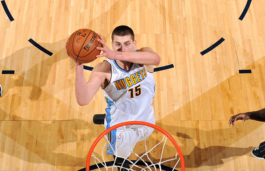 DENVER, CO - JANUARY 16: Nikola Jokic #15 of the Denver Nuggets goes for the dunk during the game against the Orlando Magic on January 16, 2017 at the Pepsi Center in Denver, Colorado. NOTE TO USER: User expressly acknowledges and agrees that, by downloading and/or using this Photograph, user is consenting to the terms and conditions of the Getty Images License Agreement. Mandatory Copyright Notice: Copyright 2017 NBAE (Photo by Garrett Ellwood/NBAE via Getty Images)