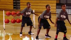 Watch Jr. NBA Coach Jeremiah Boswell show how to cover more ground on your defensive slides with the Side/Lateral Push Drill.