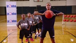 Watch WNBA legend Kiesha Brown teach how to rebound at the highest point and protect the basketball with the Toss and Get It Drill.